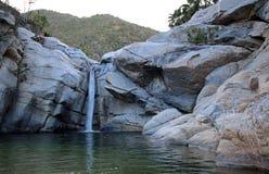 Waterfall and natural swimming pool at Cascada Sol Del Mayo on the Baja California peninsula in Mexico. BCS Royalty Free Stock Photos