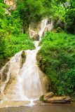 Waterfall in nature park, Thailand stock images