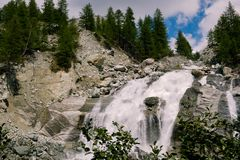 Waterfall on the Navisence river in Val d` Anniviers, Switzerland. Waterfall on the Navisence river in the Val d` Anniviers valley near Zinal in the Swiss canton royalty free stock images