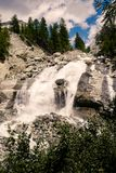 Waterfall on the Navisence river in Val d` Anniviers, Switzerland. Waterfall on the Navisence river in the Val d` Anniviers valley near Zinal in the Swiss canton royalty free stock photography