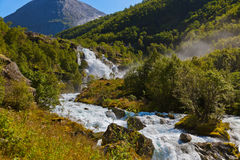 Waterfall near Briksdal glacier - Norway stock images