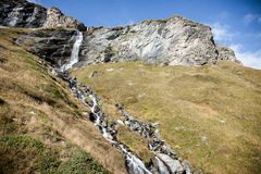 Waterfall near Matterhorn, Breuil-Cervinia, Aosta region, Italy Royalty Free Stock Photo
