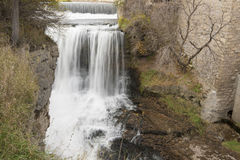 Waterfall near old building Royalty Free Stock Photos