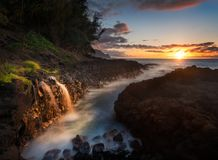 Waterfall near Queens Bath in Princeville Kauai Stock Photos