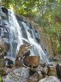 Waterfall Neozhidanniy in the forest. Royalty Free Stock Images