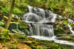 Waterfall in New Hampshire. New Hampshire has many small but beautiful waterfalls.  Most of these waterfalls require a walk or hike in the woods Royalty Free Stock Image