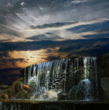 Waterfall at night at sunset Royalty Free Stock Photos