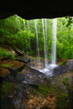 Waterfall in northern Alabama. View from behind a tranquil waterfall on Cane Creek in northern Alabama Stock Photography