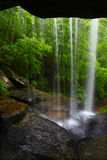 Waterfall in northern Alabama. View from behind a tranquil waterfall on Cane Creek in northern Alabama Royalty Free Stock Photography
