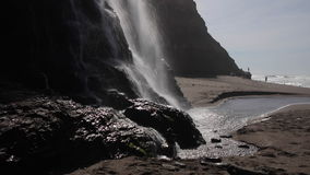 Waterfall in Northern California. The Alomere waterfall flows from a cliff to the beach at Point Reyes National Seashore in northern California. This beautiful stock video footage