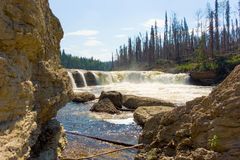 A waterfall in the northwest territories. Water rushing over an escarpment at a remote location in northern canada Stock Images