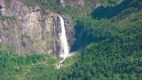 Waterfall in Norway. Big Waterfall falling from the cliff in Norway stock video footage