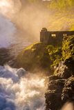 Waterfall in Norway. With old building Royalty Free Stock Photography