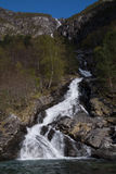 Waterfall in Norwegian fjord Stock Photo