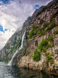 Waterfall in the Norwegian fjords Stock Images