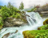 Waterfall in the town Geiranger, Norway. Waterfall in the Norwegian town Geiranger UNESCO World Heritage Site in the rainy day in July