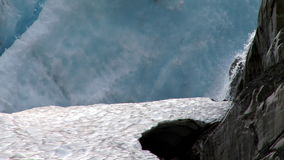 Waterfall off glacier stock video footage