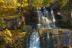 Waterfall in old autumn park. Waterfall in autumn park covered with golden leaves horiszontal scene Royalty Free Stock Photos