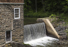 Waterfall at old stone mill Royalty Free Stock Photography