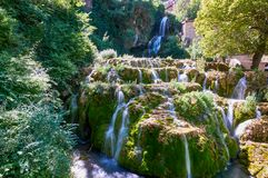 Waterfall at Orbaneja del Castillo. Waterfall falling from the centre of the town of Orbaneja del Castillo, Burgos, Spain stock images