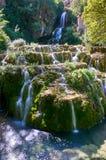 Waterfall at Orbaneja del Castillo. Waterfall falling from the centre of the town of Orbaneja del Castillo, Burgos, Spain royalty free stock photos