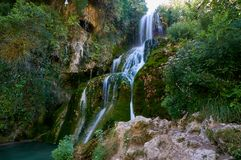 Waterfall at Orbaneja del Castillo. Waterfall falling from the centre of the town of Orbaneja del Castillo, Burgos, Spain stock photography