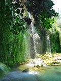 Waterfall out of grotto kursunlu Royalty Free Stock Photos