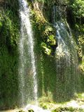 Waterfall out of grotto turkey Royalty Free Stock Images