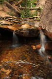 Waterfall in outdoor national park with rocks Royalty Free Stock Images