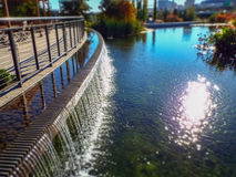 Waterfall outside patio at botanic garden in fall Stock Photos