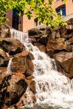 Waterfall Over Brown Rocks Stock Photos