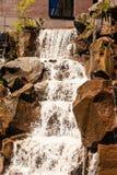 Waterfall Over Brown Rocks Stock Photo
