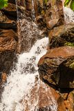 Waterfall Over Brown Rocks Stock Photography