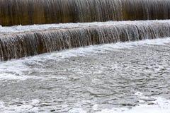 Waterfall over dam Stock Photo