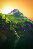 Waterfall over the Geiranger fjord Royalty Free Stock Images