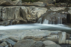 Waterfall over granite ledge on Swift River, New Hampshire. Royalty Free Stock Image