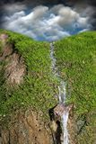 Waterfall over green moss Stock Image