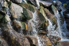 Waterfall over large rocks. Close up of splashing water over Waterfall over large rocks Stock Photos