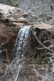 Waterfall Over Redrock Sandstone at Zion National Park in Southern Utah. In Winter Showing Water in the Desert royalty free stock photography