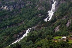 Waterfall over Sandvevatnet lake near Odda in Hordaland county, Norway. Waterfall over Sandvevatnet lake near Odda in Hordaland county, Norway stock photos