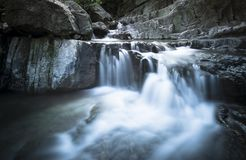 Waterfall over sliver rock. In long-time exposure royalty free stock image