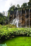 Waterfall over small lake Stock Photography