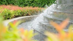 Waterfall over the stairs in the garden stock footage