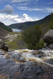 Waterfall overlooking glendalough upper lake. This special viewpoint is from the waterfall feeding glendalough lake stock photography
