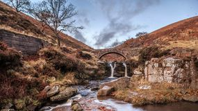 Waterfall and pack horse bridge Stock Images
