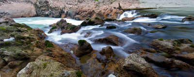 Waterfall panorama. Panorama of a waterfall, Buller Gorge, New Zealand royalty free stock images