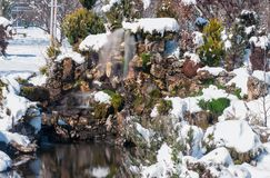 Waterfall in the park. Artificial Small Waterfall in the park covered with snow, Strumica, Macedonia Royalty Free Stock Photography