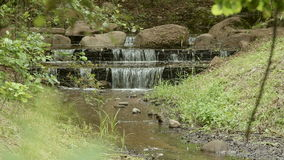 Waterfall in the park stock video footage