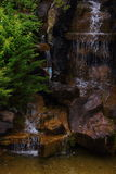 Waterfall. In the park among the trees waterfall pours Stock Photo