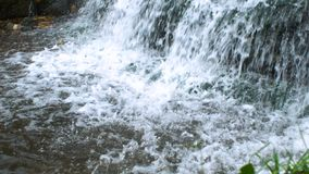 Waterfall in park stock video footage